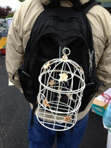 A bird cage that Guy will use as a planter. The clips on his back pack have come quite handy.