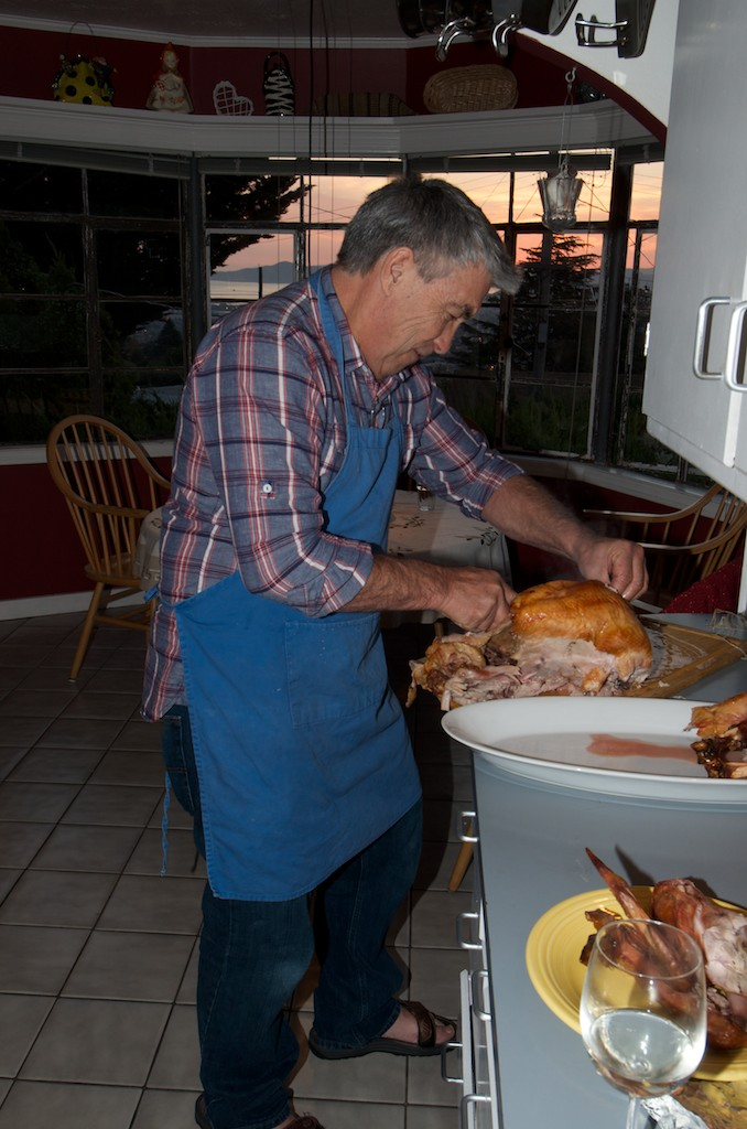 Stevie traditionally carves the turkey. Wonderful view of the bay from their kitchen.
